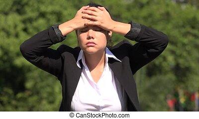 Stressed Hispanic Business Woman
