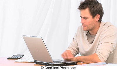 Stressed man on his laptop