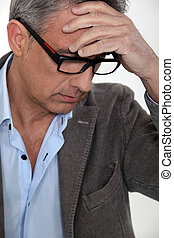 Stressed middle-aged businessman