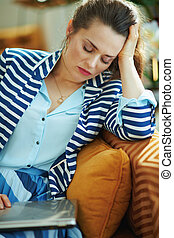 stressed modern woman sleep in front of laptop with laptop