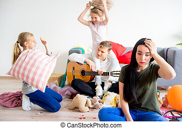 Stressed mother sees mess - A stressed mother sees mess her...