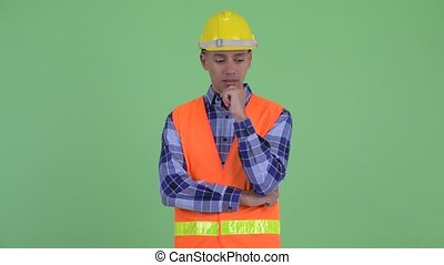 Stressed multi ethnic man construction worker thinking - ...