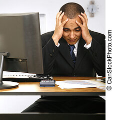 a stressed out employee holding his head with a little clock behind him showing a time to get off