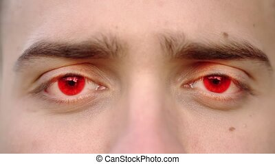 Stressed person with bright red eye pupils looks straight into camera at electric light extreme closeup computer generated imagery