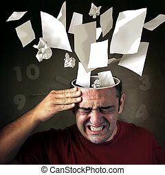 Stressed - Conceptual image of papers coming out of a mans...