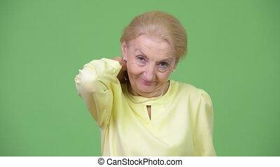 Stressed senior businesswoman having neck pain