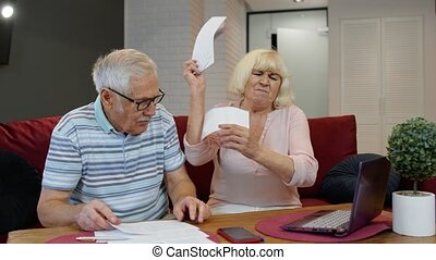 Stressed senior couple discuss unpaid bank debt holding ...