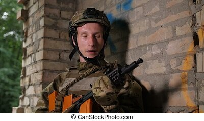Stressed soldier securing area at clearing mission -...