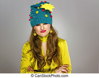 stressed stylish woman in funny Christmas hat isolated on...