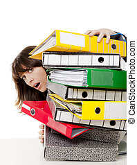 Stressed woman at the office full of folders and work to do, isolated on white background