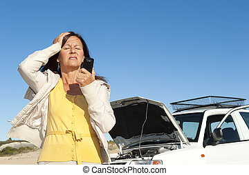 Stressed woman car breakdown - Stressed mature woman...