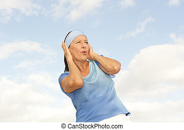Stressed Woman covering ears from noise outdoor - Portrait...
