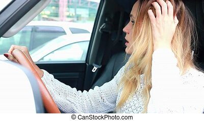 Stressed woman driver in a car.