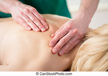 Stressed woman having back massage