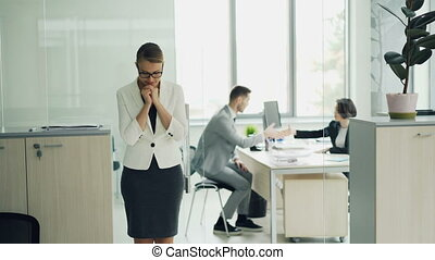 Stressed woman is standing in office room waiting for job...