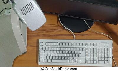 Stressed woman office worker smashing desktop computer view...