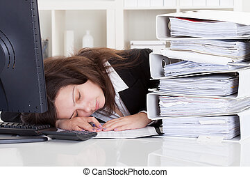 Stressed Woman Sleeping In Office - Stressed Businesswoman...