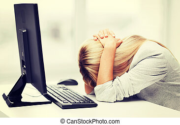 stressed woman with computer - business, office, school and ...