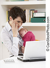 Stressed Woman With Newborn Baby Working From Home Using ...