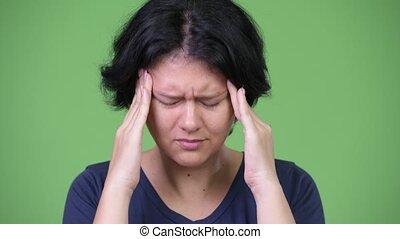Stressed woman with short hair having headache