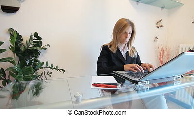 stressed woman works on laptop - stressed woman working at...