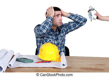 stressed worker looking at a clock