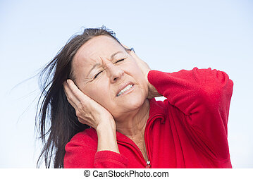 Stressed worried woman with hands on ears - Portrait...
