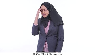 Stressed young African Muslim businesswoman getting bad news...
