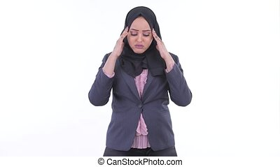 Stressed young African Muslim businesswoman having headache...
