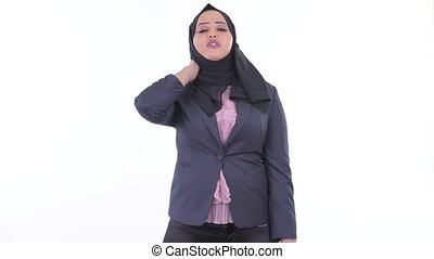 Stressed young African Muslim businesswoman having neck pain...