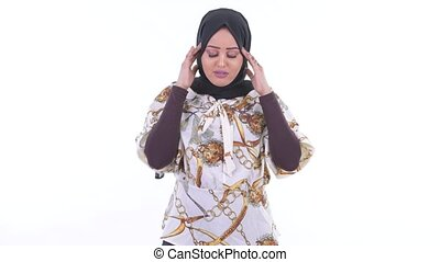 Stressed young African Muslim woman having headache - Studio...