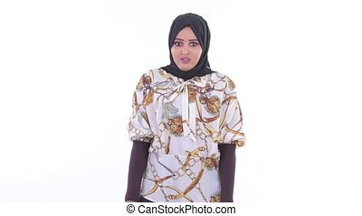 Stressed young African Muslim woman looking around - Studio...
