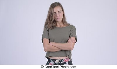 Stressed young angry woman with arms crossed - Studio shot...