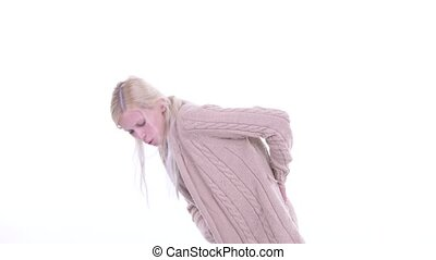 Stressed young blonde pregnant woman having back pain