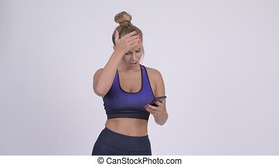 Stressed young blonde woman using phone and getting bad news...