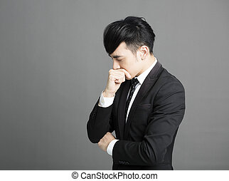 stressed Young business man with hand on head