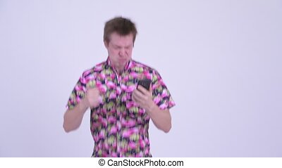 Stressed young fat tourist man with big belly using phone...