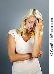 Stressed young woman - Stressed and worried young blonde...