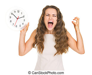 Stressed young woman with clock