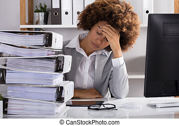 Stressful Businesswoman Sitting In Office
