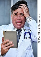 Stressful Intelligent Male Medical Professional With Tablet