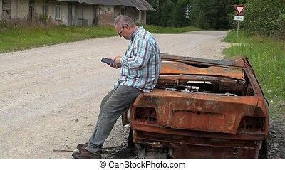Stressful man crying near the car