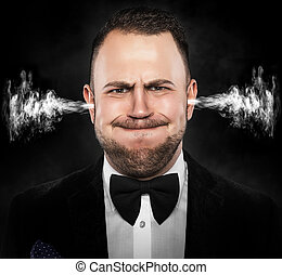 Stressful man with smoke coming out from his ears.