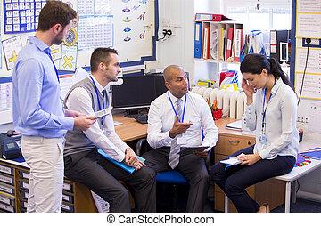 Stressful School Day - School teachers gather in a small...