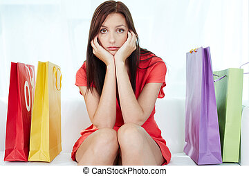 Stressful shopping - Portrait of young stressed brunette...