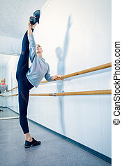 stretching at the barre