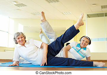 Stretching exercise - Portrait of sporty females doing ...