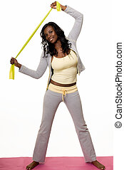 Stretching exercises - Attractive African American woman...