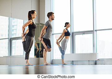 Stretching hips at yoga class