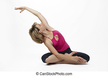Stretching in Lotos flower - Yoga poses in studio - woman ...